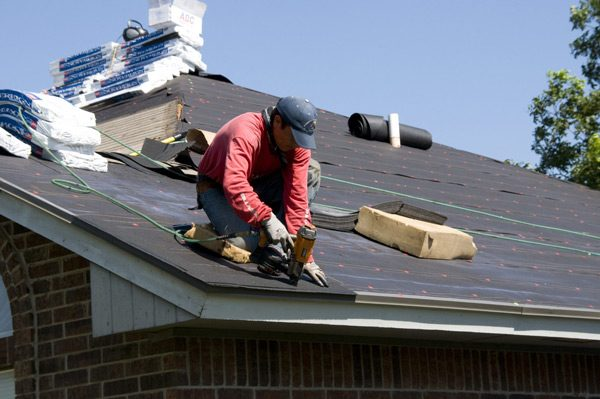 Worker Replacing Roofing Tiles