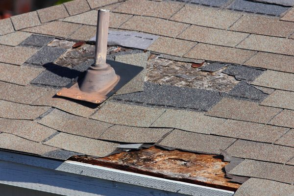 Damaged Roof with Leaks and Broken Shingles
