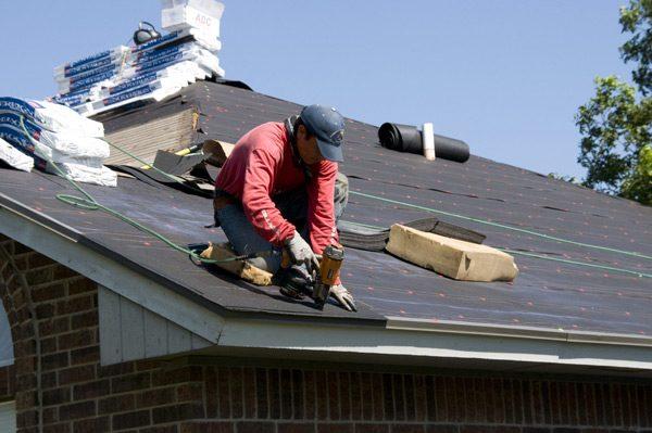 Worker Replacing Roofing Tiles
